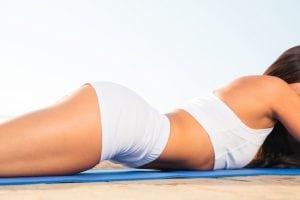 Clloseu portrait of a woman lying on yoga mat